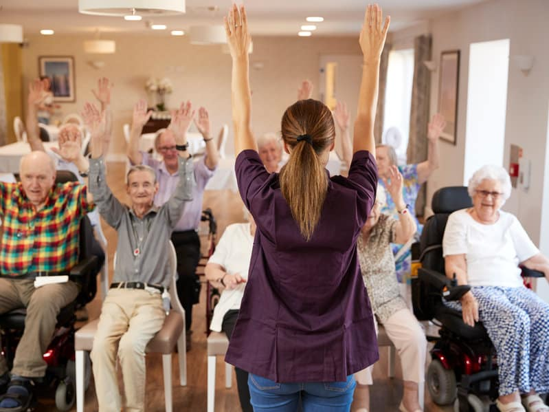 Seniors In Fitness Class In Retirement Home